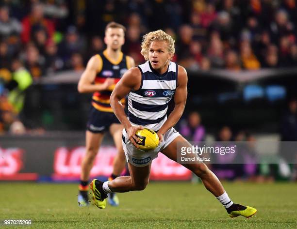 Quentin Narkle of the Cats runs with the ball during the round 17 AFL match between the Adelaide Crows and the Geelong Cats at Adelaide Oval on July...