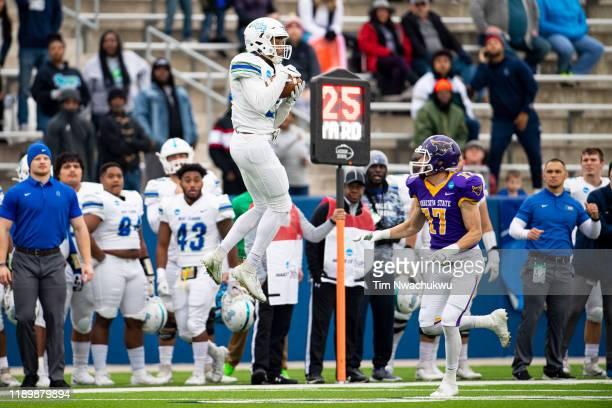 Quentin Randolph of West Florida makes a reception over Jack Curtis of Minnesota State during the Division II Men's Football Championship held at...