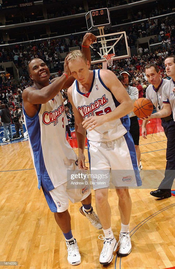 Quentin Richardson #3 of the Los Angeles Clippers congratulates Eric Piatkowski #52 after his game-winning shot after the game against the Houston Rockets at Staples Center on November 24, 2002 in Los Angeles, California. The Clippers won 90-89.