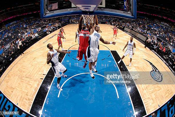 Quentin Richardson of the Orlando Magic and Chris Singleton of the Washington Wizards reach for the ball during the game on January 4 2012 at Amway...