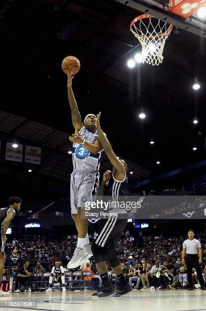 Quentin Richardson of the Power attempts a shot while being guarded by Frank Robinson of the Enemies in the second half during week seven of the BIG3...