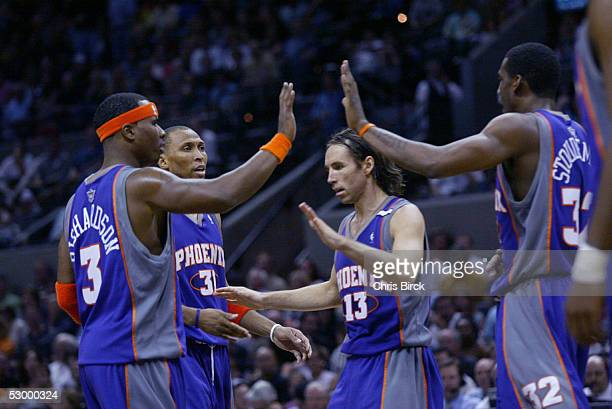 Quentin Richardson Shawn Marion Steve Nash and Amare Stoudemire of the Phoenix Suns celebrate a victory against the San Antonio Spurs in Game four of...