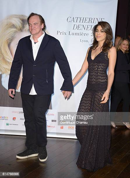 Quentin Tarantino and Daniela Pick attend the 'Prix Lumiere 2016' award during the 8th Film Festival Lumiere In Lyon on October 14 2016 in Lyon France