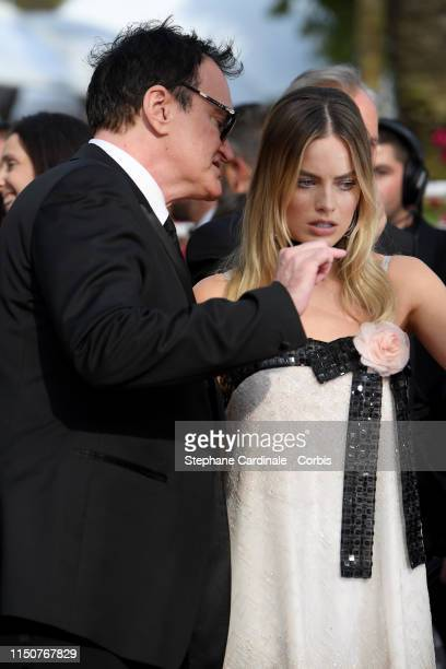 Quentin Tarantino and Margot Robbie attends the screening of Once Upon A Time In Hollywood during the 72nd annual Cannes Film Festival on May 21 2019...