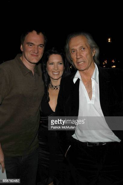 Quentin Tarantino Annie Bierman and David Carradine attend Miramax 'Max Awards' arrivals at The St Regis Hotel on February 28 2004 in Los Angeles CA