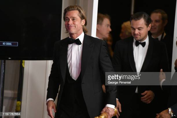 Quentin Tarantino Brad Pitt Julia Butters and Leonardo DiCaprio arrive in the press room during the 77th Annual Golden Globe Awards at The Beverly...