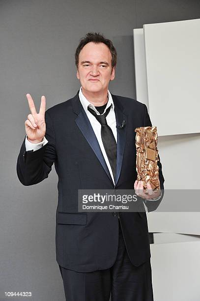 Quentin Tarantino poses with his Honorary Cesar Award for Lifetime Achievement during the 36th Cesar Film Awards at Theatre du Chatelet on February...