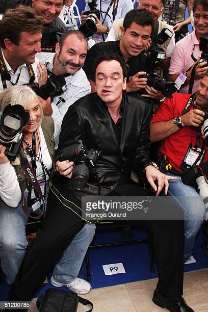 Quentin Tarantino sits with the photographers as he attends the Lecon De Cinema Photocall at the Palais des Festivals during the 61st International...