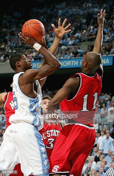 Quentin Thomas of the North Carolina State Wolfpack tries to stop Jackie Manuel of the North Carolina Tar Heels during their game on February 3 2005...