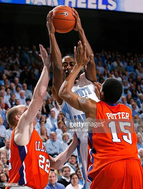 Quentin Thomas of the North Carolina Tar Heels drives between Terrence Oglesby and David Potter of the Clemson Tigers during the first half at the...