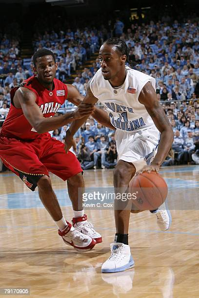 Quentin Thomas of the North Carolina Tar Heels moves the ball while Adrian Bowie of the maryland Terrapins chases after him during the college...