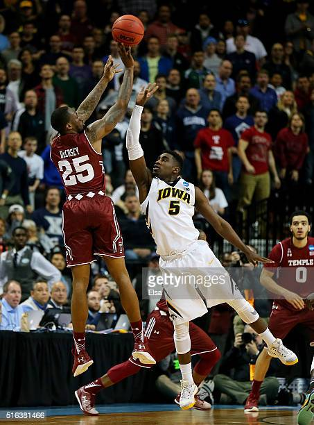Quenton DeCosey of the Temple Owls is fouled by Anthony Clemmons of the Iowa Hawkeyes against the Temple Owls the end of the second half during the...