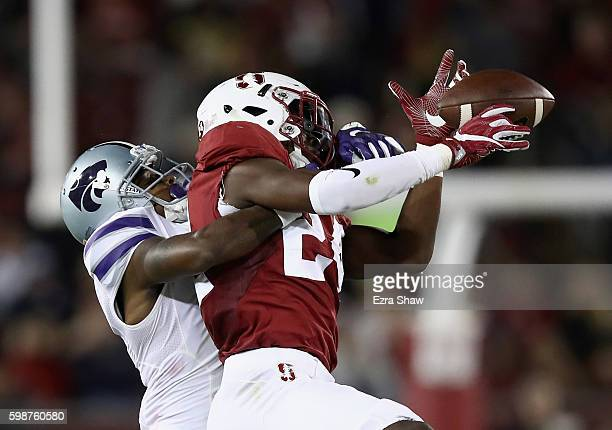 Quenton Meeks of the Stanford Cardinal intercepts a pass intended for Dominique Heath of the Kansas State Wildcats at Stanford Stadium on September 2...