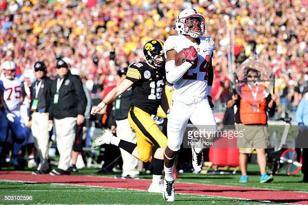 Quenton Meeks of the Stanford Cardinal returns an interception for a touchdown past quarterback CJ Beathard of the Iowa Hawkeyes in the first quarter...