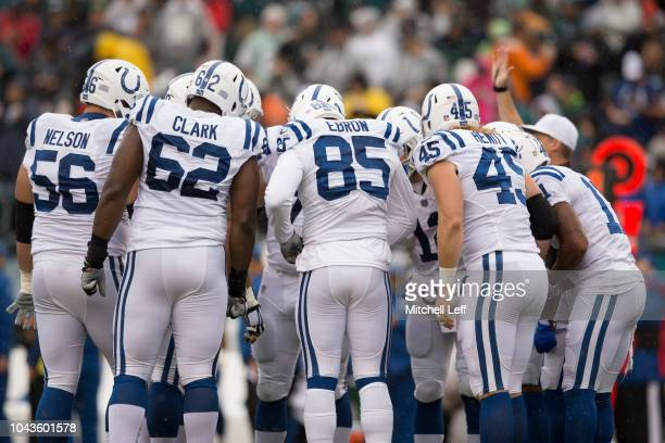 Quenton Nelson Le'Raven Clark Eric Ebron Andrew Luck Ryan Hewitt and Ryan Grant of the Indianapolis Colts huddle against the Philadelphia Eagles at...