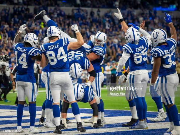 Quenton Nelson of the Indianapolis Colts and other members of the Indianapolis Colts do a u201ckeg standu201d celebration after a Colts touchdown in...