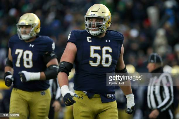 Quenton Nelson of the Notre Dame Fighting Irish walks across the field in the second quarter against the North Carolina State Wolfpack at Notre Dame...