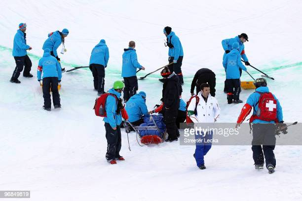 Queralt Castellet of Spain is tended to as she is prepared for transport after she was injured during a practice run for the women's snowboard...