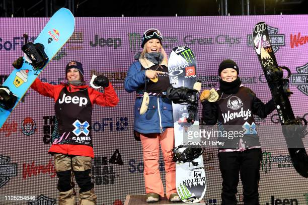 Queralt Castellet of Spain second place Chloe Kim first place and Cai Xuetong of China third place react on the podium after the Women's Snowboard...