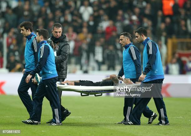 Querasma of Besiktas is carried on a stretcher off the pitch by medics after an injury during the UEFA Europa League quarter final second match...