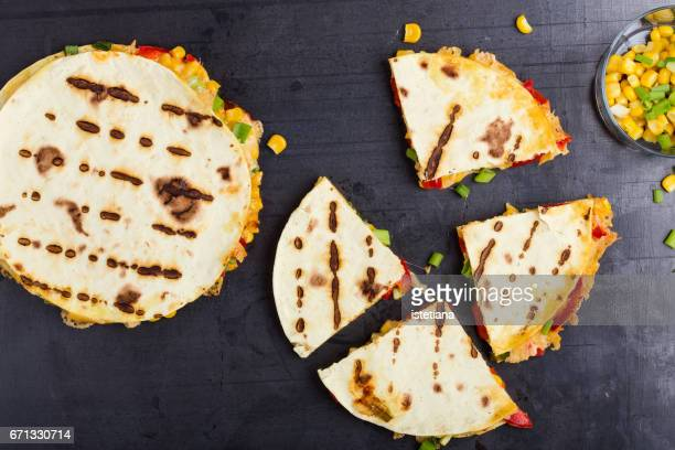 Quesadillas with corn and red bell pepper cut into wedges