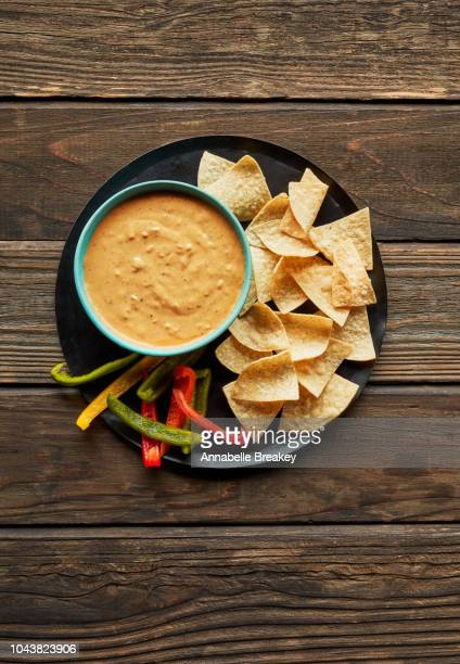 queso dip with vegetables and tortilla chips. - dipping sauce stock pictures, royalty-free photos & images