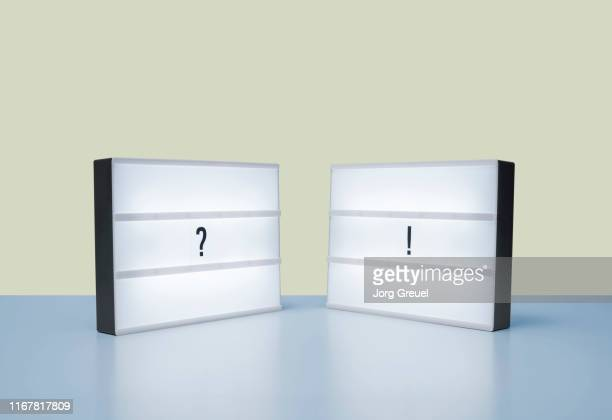 question mark and exclamation point on lightboxes - lightbox stock pictures, royalty-free photos & images