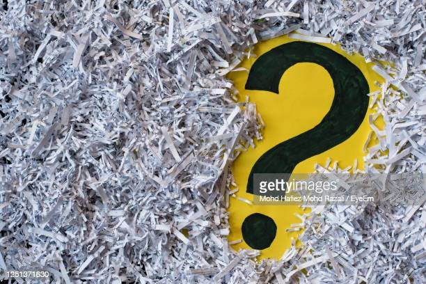 question mark in a shredded paper. - q and a stock pictures, royalty-free photos & images