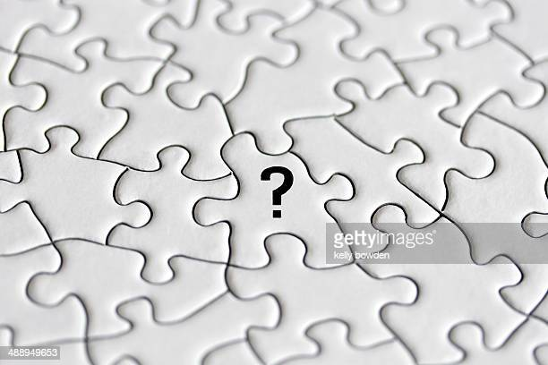 Question mark on a puzzle piece