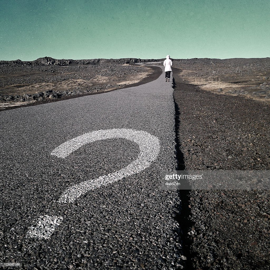 Question mark on asphalt walkway : Stock Photo