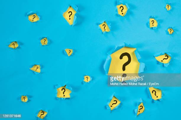 question mark on blue torn paper - q and a stock pictures, royalty-free photos & images