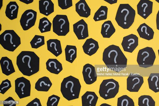 question mark on yellow background - q and a stock pictures, royalty-free photos & images