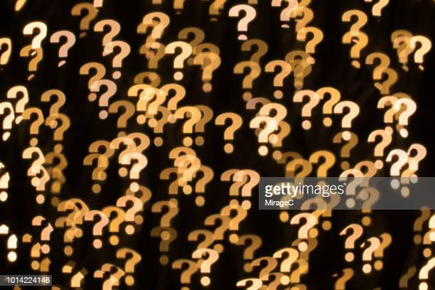 question mark shape bokeh backdrop - questions stock pictures, royalty-free photos & images