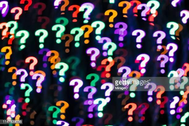 question mark shape bokeh backdrop - fragen stock-fotos und bilder