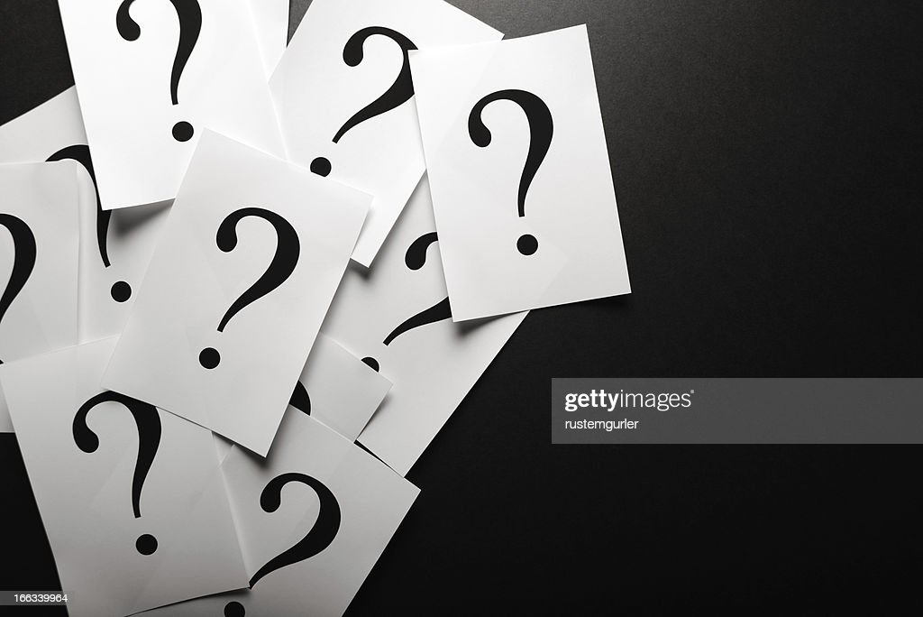Question marks on paper : Stock Photo