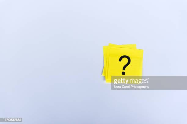question marks on sticky yellow note - q and a stock pictures, royalty-free photos & images