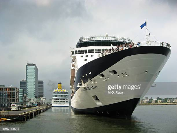 which cruiseship is bigger Answer the one in the back The ship in front is called Celebrity Constellation Passenger Terminal Amsterdam in the Eastern...