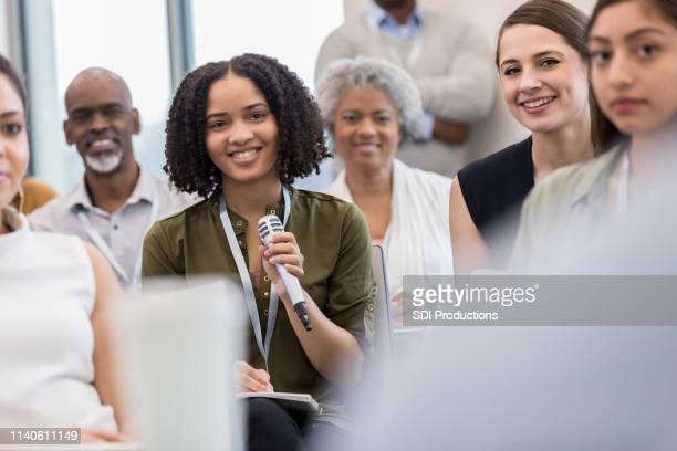questions during  the library town hall meeting - town hall stock pictures, royalty-free photos & images