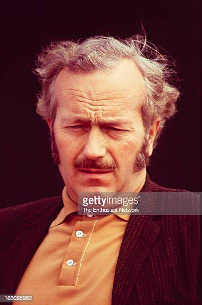 Questor Grand Prix Lotus founder Colin Chapman hangs around by the paddock