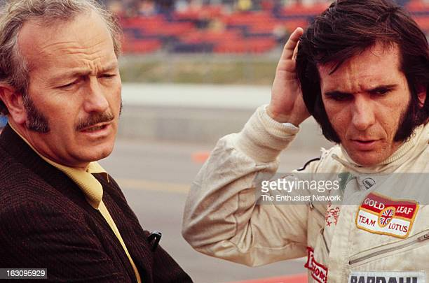 Questor Grand Prix Lotus founder Colin Chapman talks to his driver Emerson Fittipaldi The two of them will go on to win a Formula One World...