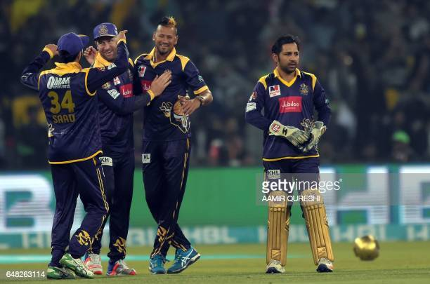 Quetta Gladiators bowler Payad Emrit celebrates with teammates after taking the wicket of Peshawar Zalmi batsman Iftikhar Ahmed during the final...