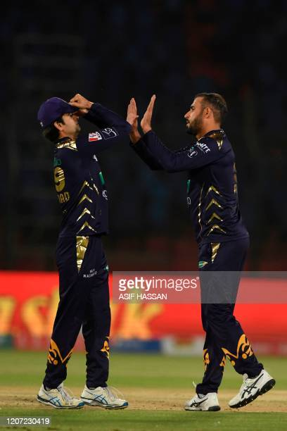 Quetta Gladiators Fawad Ahmed celebrates the wicket of Karachi Kings Babar Azam during the Pakistan Super League T20 cricket match between Karachi...