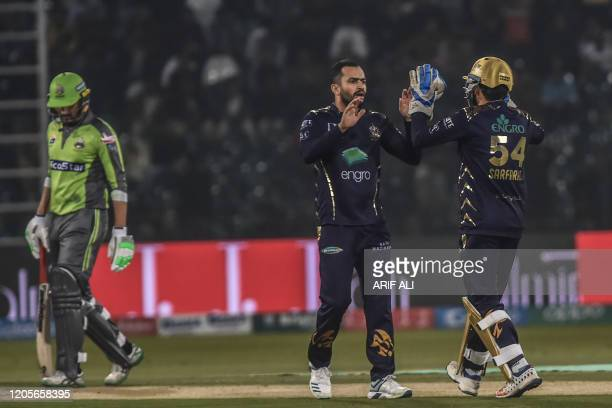 Quetta Gladiators Mohammad Nawaz celebrates with Sarfraz Ahmed the wicket of Lahore QalandarsFakhar Zaman walks back to the pavilion during...