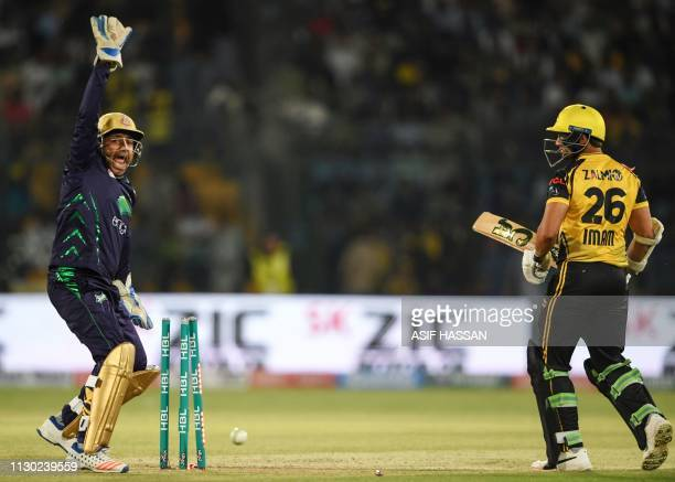 Quetta Gladiators Pakistani captain Sarfraz Ahmed celebrates after dismissing Peshawar Zalmi cricketer Imam ul Haq during the qualifier match between...