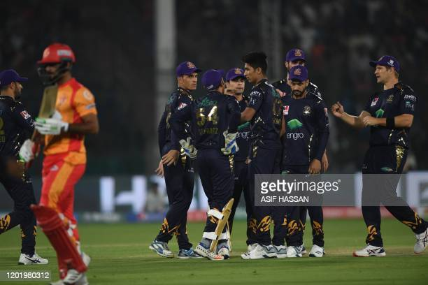 Quetta Gladiators' players celebrate after dismissal of Islamabad United's Hussain Talat during the Pakistan Super League Twenty20 cricket match...