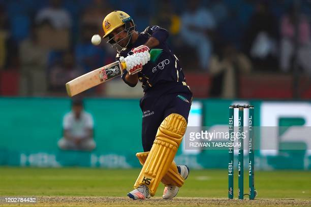 Quetta Gladiators Sarfaraz Ahmed hits the ball during the Pakistan Super League T20 cricket match between Karachi Kings and Quetta Gladiators in the...