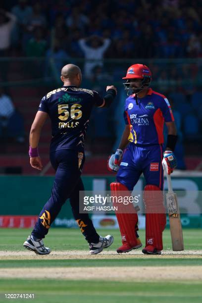 Quetta Gladiators Tymal Mills celebrates after bowling Karachi Kings Babar Azam during the Pakistan Super League T20 cricket match between Karachi...