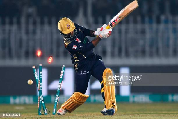 Quetta Gladiators's captain Sarfraz Ahmed is bowled out during the Pakistan Super League Twenty20 cricket match between Quetta Gladiators and...
