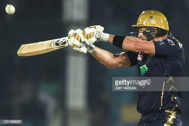 Quetta Gladiators's Shane Watson plays a shot during the Pakistan Super League Twenty20 cricket match between Quetta Gladiators and Islamabad United...