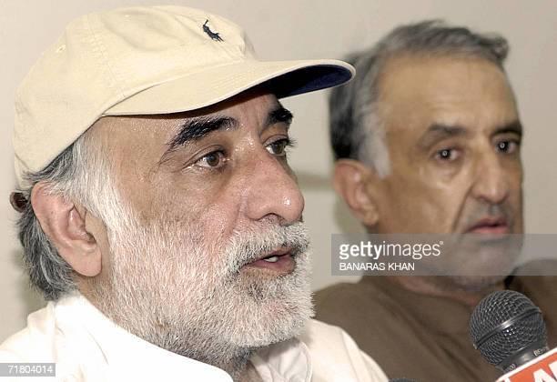 Jamil Bugti son of slain rebel tribal chief Nawab Akbar Bugti speaks to media representatives as his brother Talal Bugti looks on during a press...